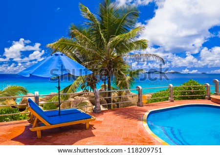 Pool at tropical beach - vacation background - stock photo