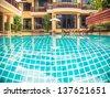 Pool at  villa resort. - stock photo
