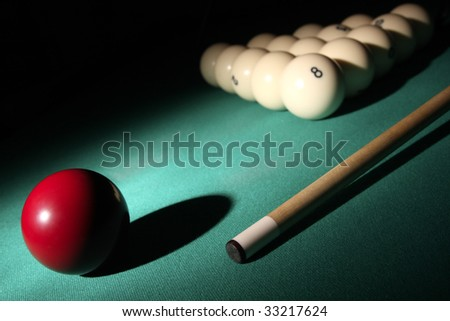 Pool balls and cue on light beam. Balls pyramid with number 8 ball on a background.
