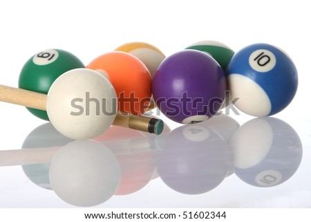Pool balls and end of cue with reflection - stock photo