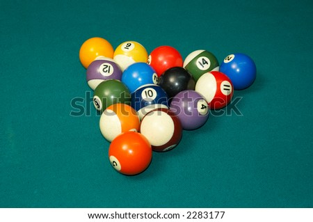 pool balls arranged on felt as triangle - stock photo