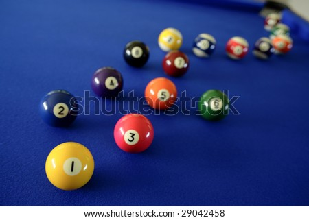 Pool balls on blue table