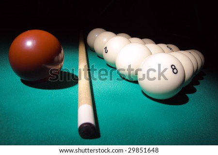 Pool balls on light beam. Balls pyramid with number 8 ball on a foreground. - stock photo