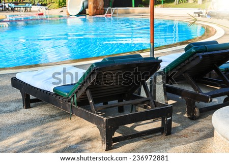pool bed beside swimming pool