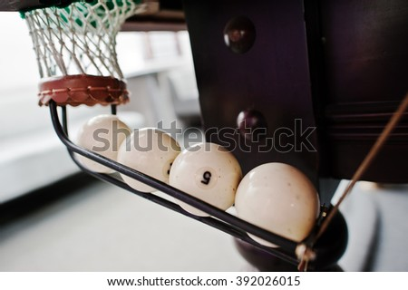 Pool billiards ball in the hole - stock photo