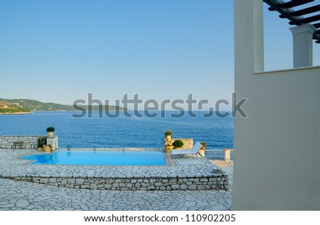 Pool by luxury villa with a view on Corfu Island, Greece - stock photo