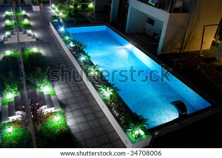 Pool by night - stock photo