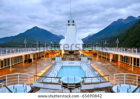 pool deck of luxury cruise ship near alaska coast - stock photo