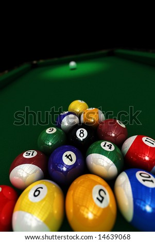 Pool game - set of pool balls ready to start the game - shallow depth of field with focus on the eight ball - stock photo