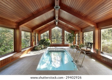 Pool in luxury home with wood ceiling - stock photo