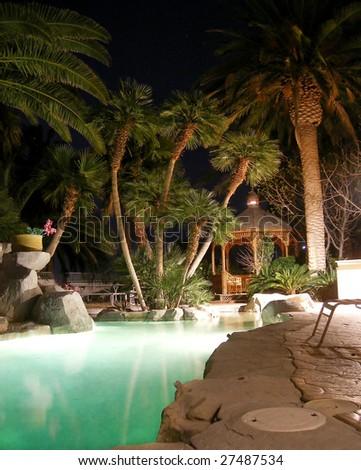 pool in the backyard at night - stock photo