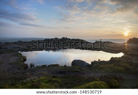 pool landscape at sunset with lovely colors and reflections - stock photo