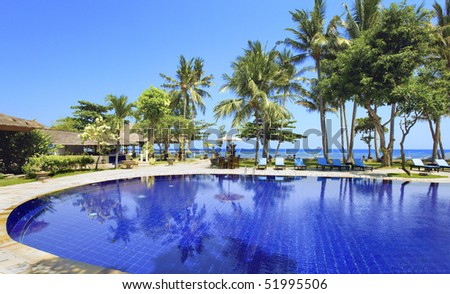 Pool, ocean, palm trees.  Indonesia. Bali.