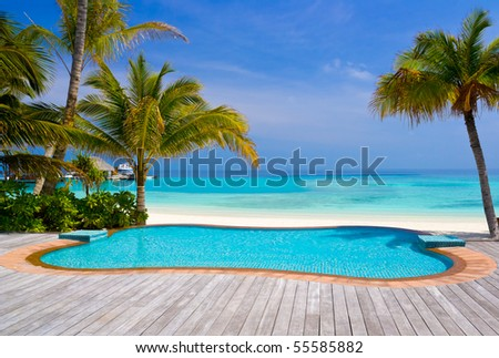 Pool on a tropical beach - vacation background - stock photo