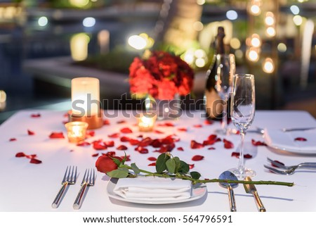 Pool side Candlelight Dinner and Romantic Sunset Dining table setup for couple with bottle of ch&agne & Pool Side Candlelight Dinner Romantic Sunset Stock Photo (Royalty ...