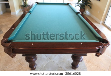 Pool table in a recreation room. - stock photo