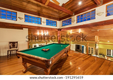 Pool Table in Luxury Home - stock photo