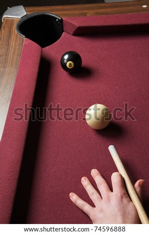 pool table showing persons arm lined up for winning shot - stock photo