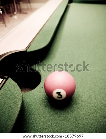 Pool table with one ball - stock photo