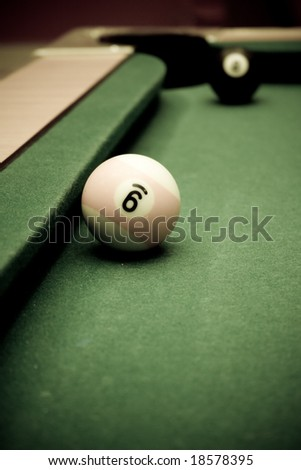 Pool table with two balls - stock photo