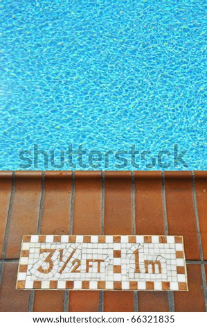 Pool with depth marking, room for your text - stock photo