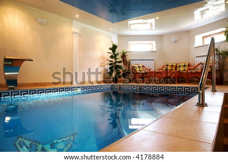 Pool with pure water in modern hotel - stock photo