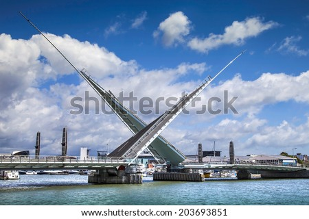 POOLE, DORSET, UK - JUNE 09, 2012: The Twin Sails Bridge linking holes Bay with Poole Harbour opened to traffic in April 2012 after delays caused by problems with the mechanism and road surface - stock photo