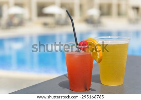 Poolside happy hour cocktails at an all inclusive resort hotel. - stock photo