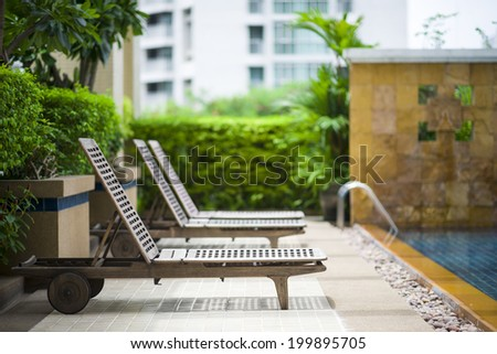 Poolside lounge chair - stock photo