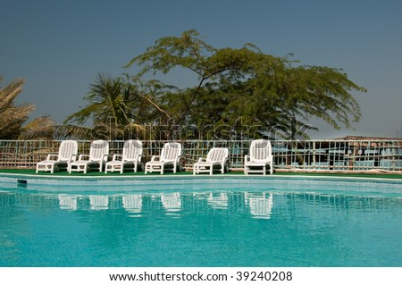 Poolside Relaxation - stock photo