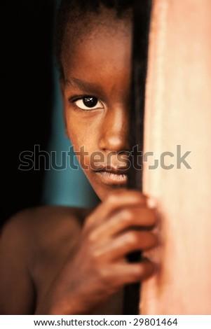 poor african child in the door, village near Kalahari desert, Botswana - stock photo