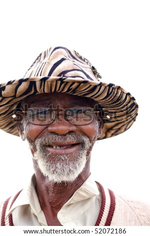 Poor black South African man wearing glasses and a hat.