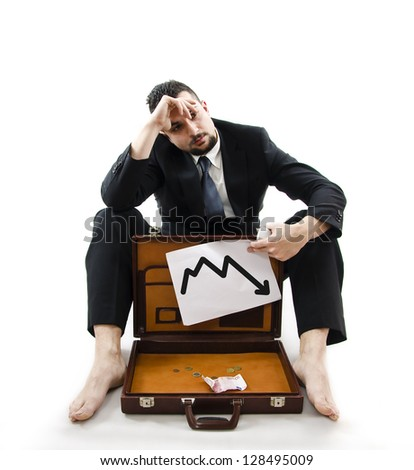 Poor businessman. The crisis effects - stock photo