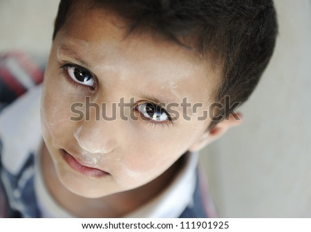 Poor dirty kid - stock photo