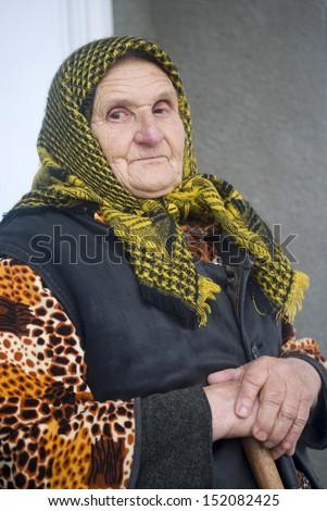 Poor elderly woman of Eastern Europe - stock photo