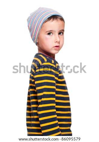 Poor homeless orphan child boy in striped sweater isolated on white - stock photo