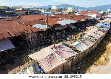 poor houses with sheet tin by the river, Kota Manado, North Sulawesi, Indonesia - stock photo