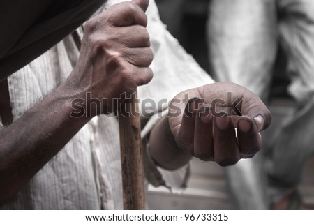 poor man's hands begging for money on the street - stock photo