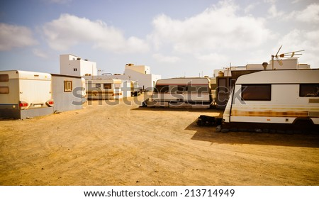 Poor people living in untidy trailers not far form fabulous holidays resorts. Puerta de la Cruz, Fuerteventura, Canarias - stock photo