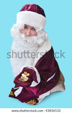 Poor Santa with the coins on the hand. Focus point on the face. Isolated on blue. - stock photo