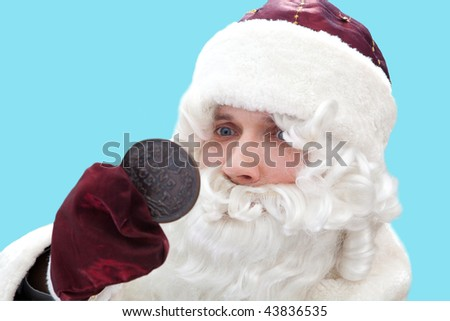 Poor Santa with the one cent coin. Isolated on blue. - stock photo