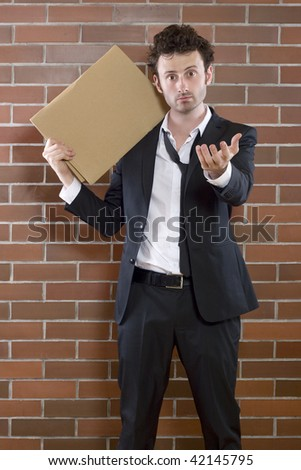 poor young unshaved businessman standing pleading with a blank sign