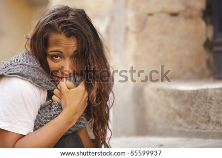 poor young woman in cold weather - stock photo