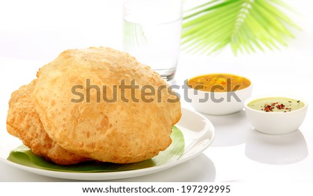 Poori Saagu - Delicious deep fried poori (puri) served with spicy potato onion curry (saagu) and chutney - stock photo