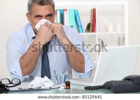 Poorly businessman - stock photo