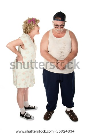 Poorly dressed couple engaged in a serious argument - stock photo