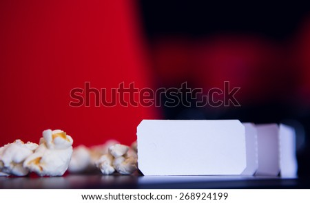 Pop corn and cinema tickets at the cinema - stock photo