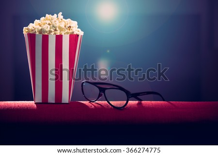 pop corn and 3d glasses on armchair cinema - stock photo