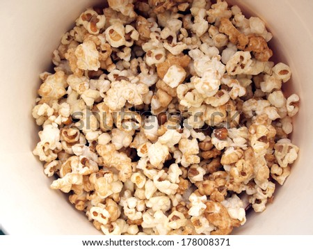 pop corn in caramel syrup in the paper box - stock photo