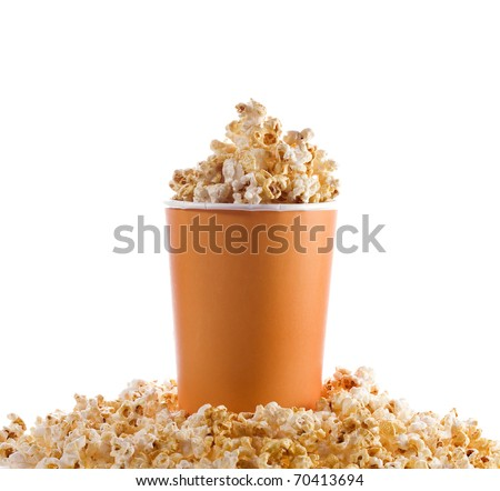 pop corn in caramel syrup in the paper box isolated on white - stock photo